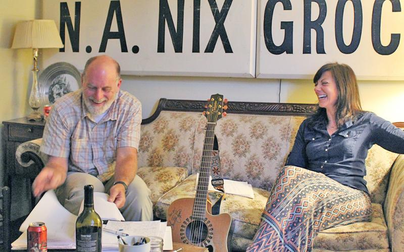 Songwriter Betsy Franck works with Billy Luesing on the lyrics of Luesing's original song during the first Song Saloon meeting. The group meets on the 2nd and 4th Tuesday of each month at The Crimson Moon from 7-9 p.m.