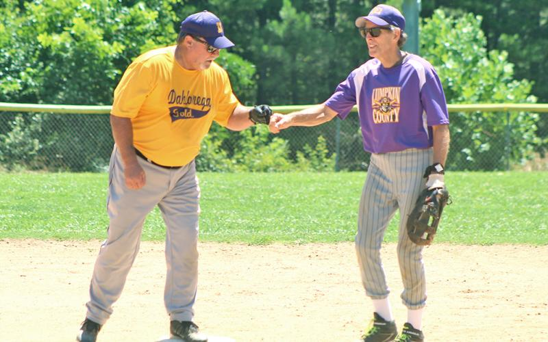 "Miners second baseman Larry ""Motoring"" Morton congratulates the Dahlonega Gold's Mike ""Walloping"" Williams after Williams belted a double in game two of a non-league doubleheader last week."