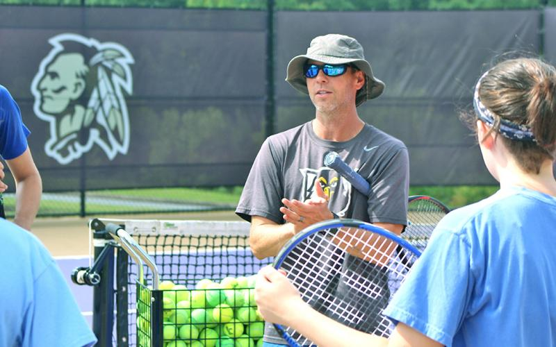 UNG head tennis coach Kent Norsworthy talks to campers at the LCHS Tennis Camp.