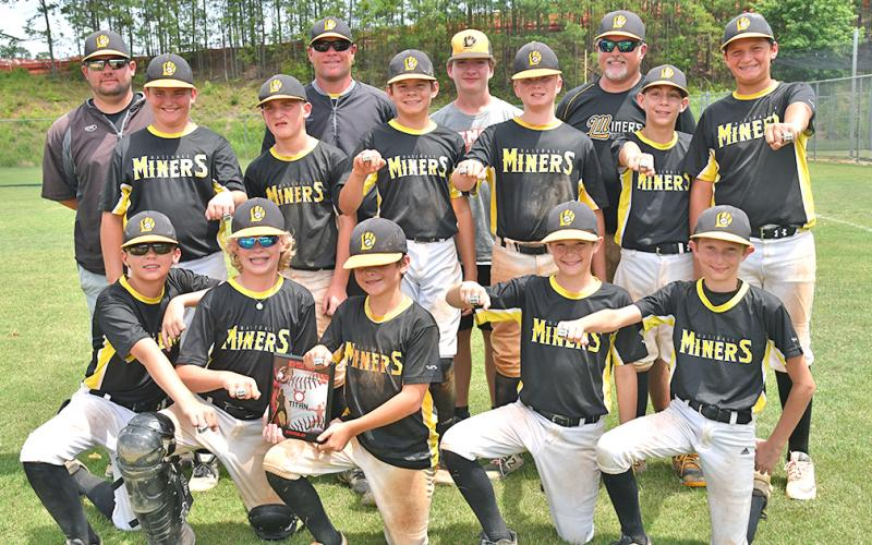 The Lumpkin Miners 12U baseball team shows off their runner-up rings from one of the tournaments they participated in during the 2019 spring season. The Miners went 26-14 during the three-month season.