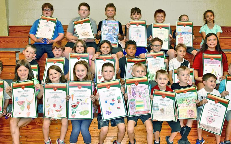 Park & Rec's Day Camp participants took part in a poster contest for Community Helping Place Free Medical and Dental Clinics annual Tomato Sandwich Supper. Winners (first, second and third place) will be revealed Thursday, July 18, at Dahlonega Baptist Church during the event. Pictured are (first row, from left) Jacob Giles, Charlotte Gass, Madeline Gass, Jersey Ward, Colby Henderson, Micah Ellis, Christian Cotour, Landen Popham, Harlen Wager and Joey Moses; (second row, from left) Ethan Starley, Talon Ston