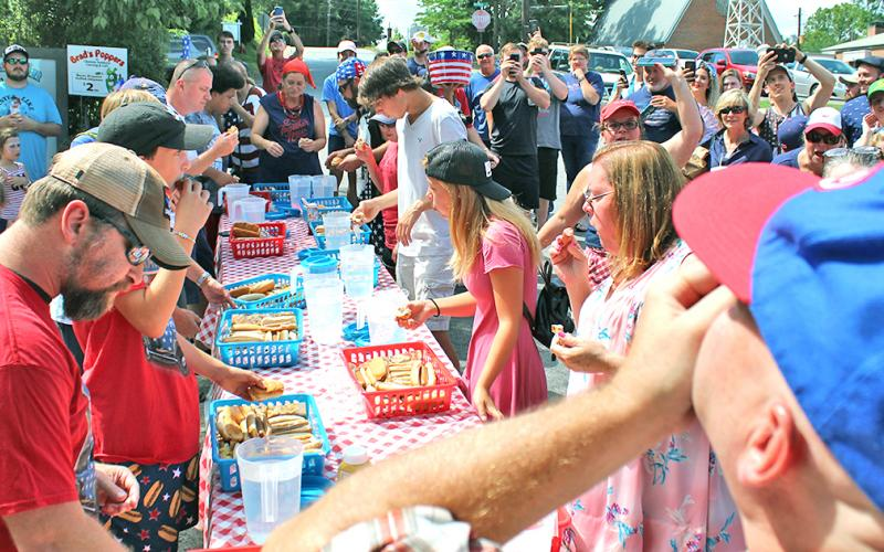 A total of 11 participants came to downtown Dahlonega to compete for a $100 prize and the honor of being the first Fourth of July hot dog eating contest champion.