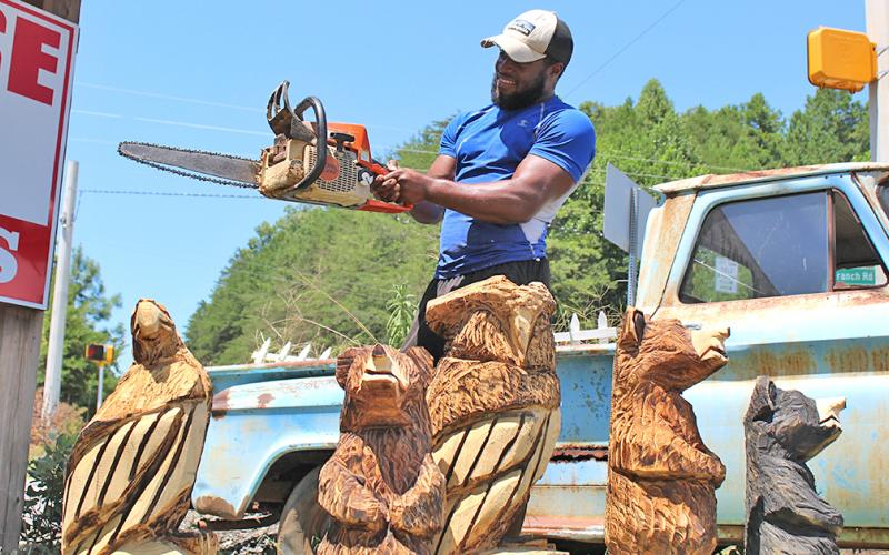 Devonte Young has spent years honing his craft as a chainsaw artist while working under the tutelage of renowned carver Michael Von Schroth. You can usually find Young and his carvings on the corner of Long Branch Road and Highway 52.