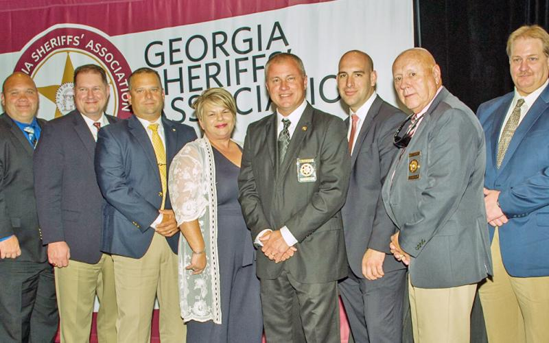 Attendees included, from left, Captain Marcus Sewell, Lieutenant Alan Roach, Captain Brendan Garland, Administrative Assistant to the Sheriff Rhonda Shepard, Sheriff Stacy Jarrard, Detention Division Staff Sergeant Noel Poisson, Chief Deputy Doug Cochran and Communications Director Carlton Chester. Senator Steve Gooch, Representative Kevin Tanner and Lumpkin County Coroner Jim Sheppard were on hand as well as Judge Michael Chastain led the swearing in ceremony.