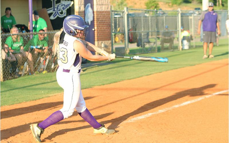 Lauren English blasts a pitch to right field for a two-run double to help Lumpkin defeat Pickens County last week.