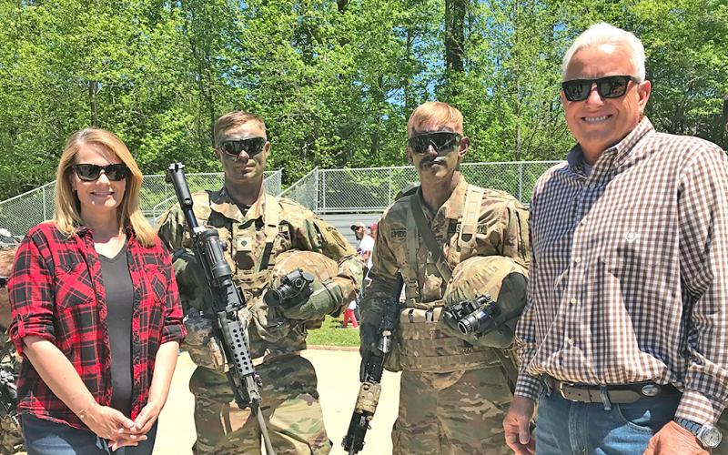 Jann Carl and Rodney Miller spend time with Army Rangers at Camp Frank D Merrill during filming earlier this year.