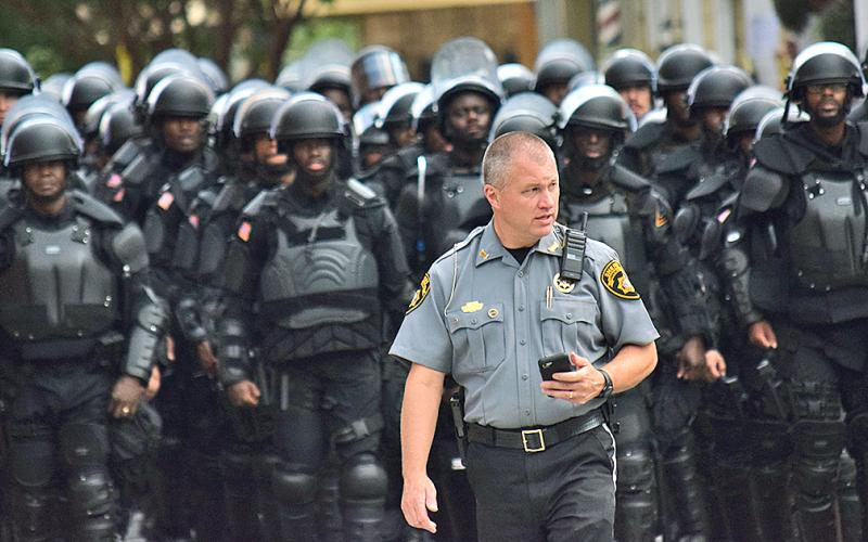 Lumpkin County Sheriff Stacy Jarrard keeps watch over the public square in Dahlonega amid hundreds of law-enforcement personnel at a political rally on September 14. (photo by Matt Aiken))