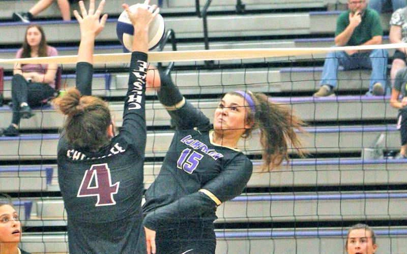 Lumpkin County's Reagan Spivey goes up strong at the net to score a point versus Chestatee last week.