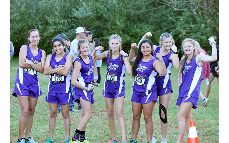 The Lady Indians cross country team flexes its muscles before earning a fourth place team finish at the Region 7-AAA championship to advance to the GHSA State Cross Country Championship Meet last week.