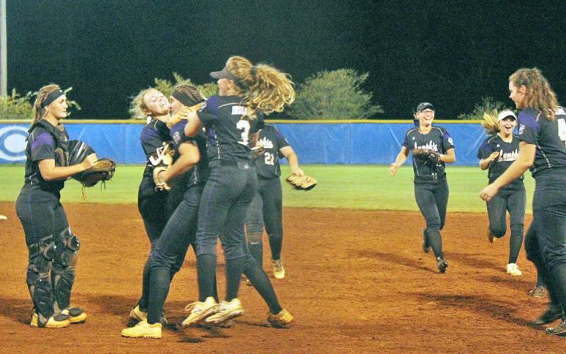 The Lady Indians celebrate their sweep of the Crisp County Lady Cougars in the Sweet 16 round of the GHSA State Softball Playoffs on Oct. 16.