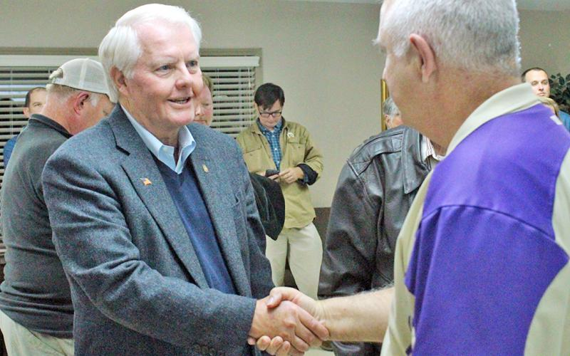 Dahlonega City Councilman Ron Larson is congratulated by County Commissioner Bobby Mayfield on election night.