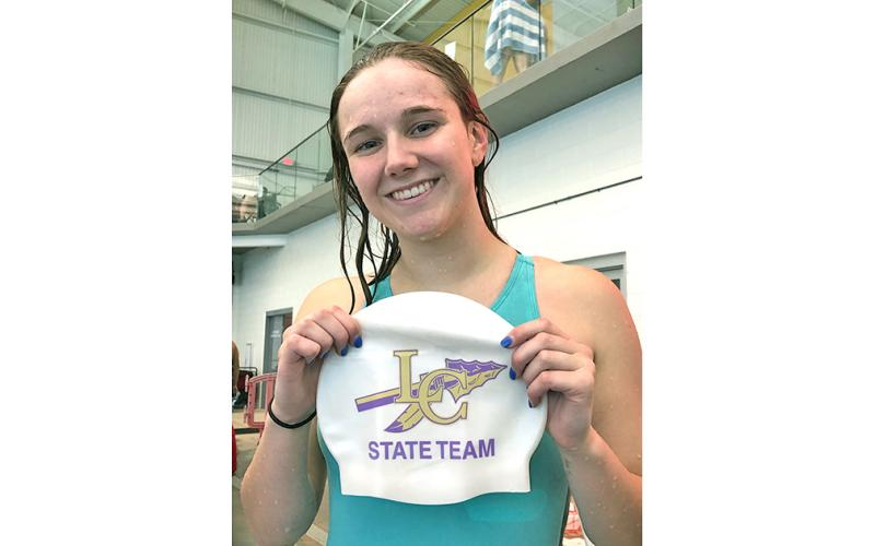 Lady Indians swimmer Faith Schofield celebrates qualifying for the State Swim Meet in the girls 100 yard freestyle during the LCHS swim team's first meet of the 2019-2020 season.