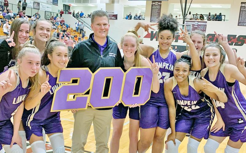 The Lady Indians celebrate LCHS head girls basketball coach David Dowse's 200th career win after defeating the Chestatee Lady War Eagles in Lumpkin's 2019-2020 season opener.
