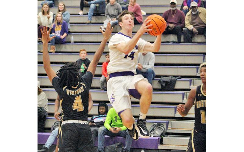 Standout Jacob Cumbie flies through the lane for two of his 17 points during Lumpkin's region win over East Hall. Cumbie finished the game with a double-double, scoring 17 points and pulling down 10 rebounds.