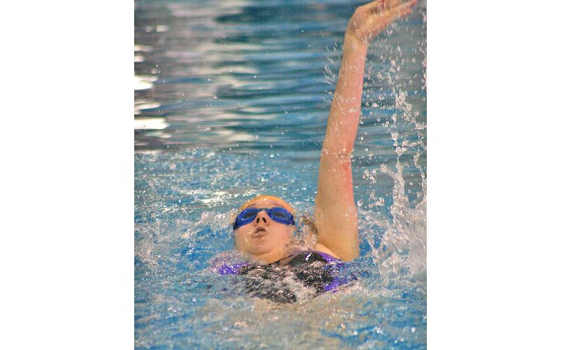 Lady Indians swimmer Faith Schofield takes part in the girls 100 yard backstroke event. Schofield had a successful day in the pool when the Lady Indians participated in the RMA Eagle Invite this past Saturday, Dec. 14.