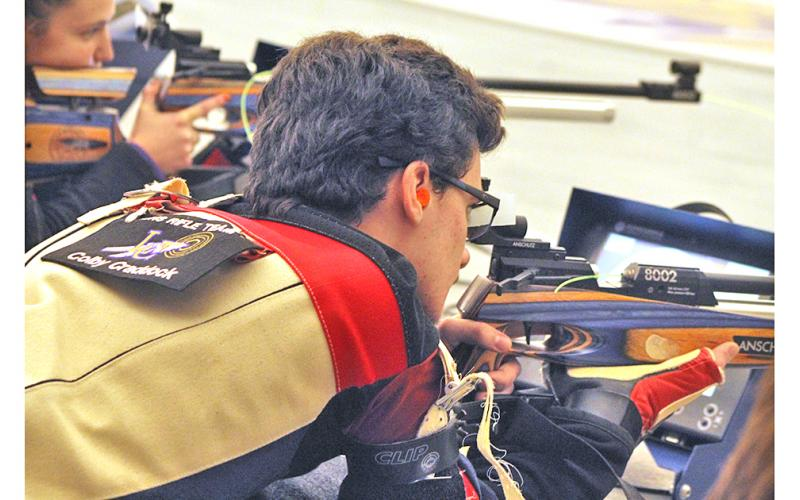 LCHS rifle team captain Colby Craddock takes aim during competition. Craddock earned Top Gun honors for the Indians to help Lumpkin eke out a win versus Duluth High School at the Indian Hunting Grounds last Thursday, Dec. 19.