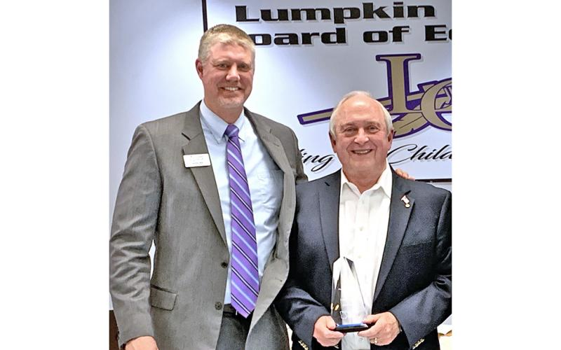 Former Superintendent of Schools David Luke (right) was back at his old stomping ground, the December meeting of the Lumpkin County Board of Education, to accept the Pioneer in Education Award from Justin Old, Director of Pioneer RESA. The award is given to those whose efforts have gone above and beyond to support students and staff.