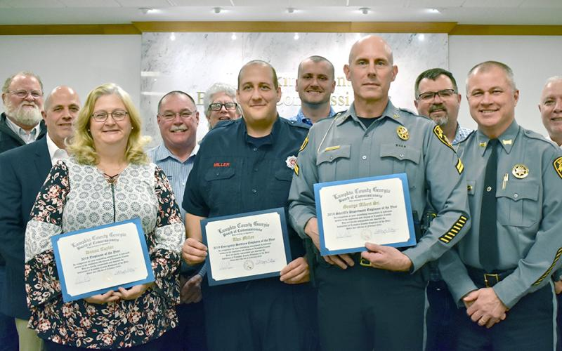 Donna Taylor from the Planning Department (front row, left to right), Fire/EMS's Alex Miller and SRO Officer George Albert Sr. are Lumpkin County's 2020 Employees of the Year. The trio were honored at last month's BOC meeting. Standing with those being honored are (back row, from left) Public Works Director Larry Reiter; Commissioner Jeff Moran; EMS Director David Wimpy; Commissioners David Miller, Rhett Stringer, Chris Dockery; Sheriff Stacy Jarrard; and Commissioner Bobby Mayfield.