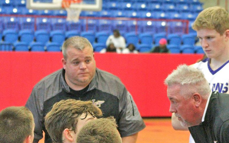 New LCHS boys basketball coach Michael Parker (left) was heavily influenced by his 12 years with retired coach Jeff Steele.