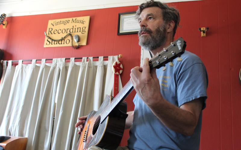 John Grimm is the man behind Vintage Music, a popular stop on the square for the past 33 years.