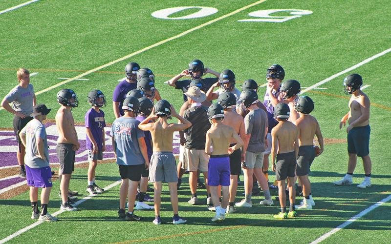 LCHS head football coach Caleb Sorrells huddles up with his players during the first day of mandatory practice on Monday.