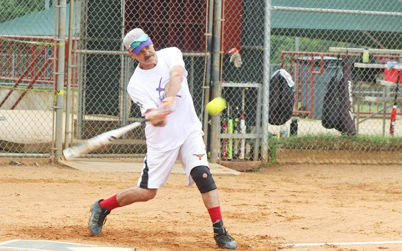 "LC Miners player ""Hammering"" Harvey Schmedlapp smashes a pitch to the gap for a triple during a Clayton League doubleheader versus the Dahlonega Gold. Schmedlapp finished the day 7-for-7 at the plate with seven runs scored and seven runs batted in with three doubles and two triples."
