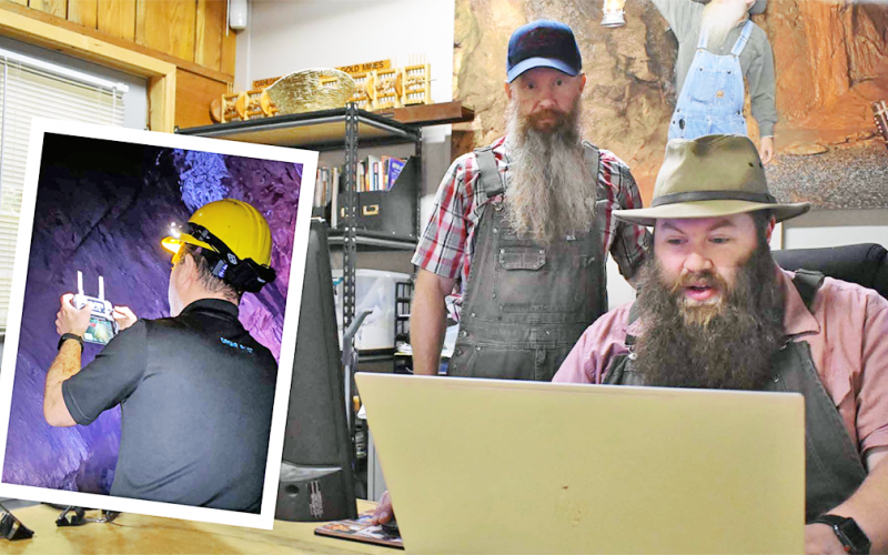 Consolidated Gold Mine manager Dathan Harbert (right) and gold miner Jamie Shedd review drone video on the computer.  (Right) Nir Pe'er of Inspired Intelligence controls a drone that is flying through previously unmapped Consolidated Gold Mine tunnels to create never-before seen maps.