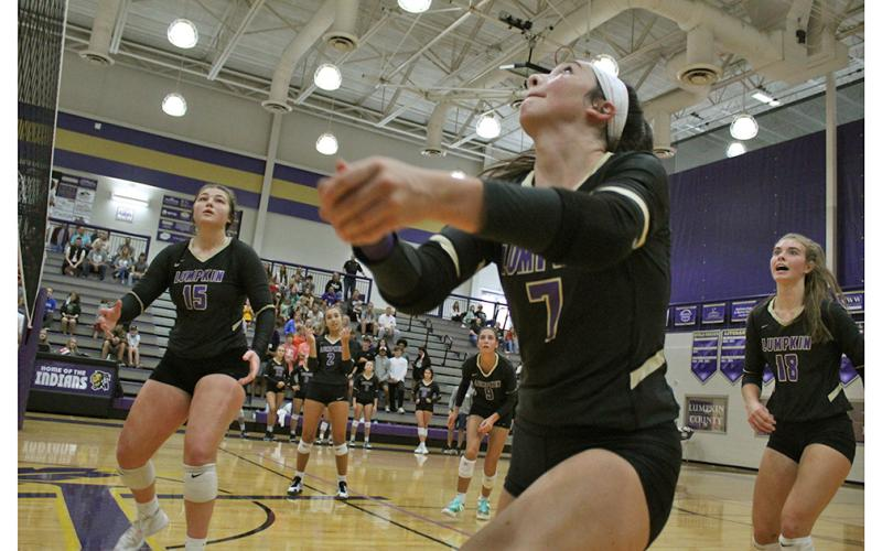 Addie Rucker focuses in to get a perfect set while teammates Reagan Spivey, Isabel Davenport, Kiersta Trammell and Victoria Crotzer look to react in time to get the ball back over the net during Lumpkin's second round playoff match.