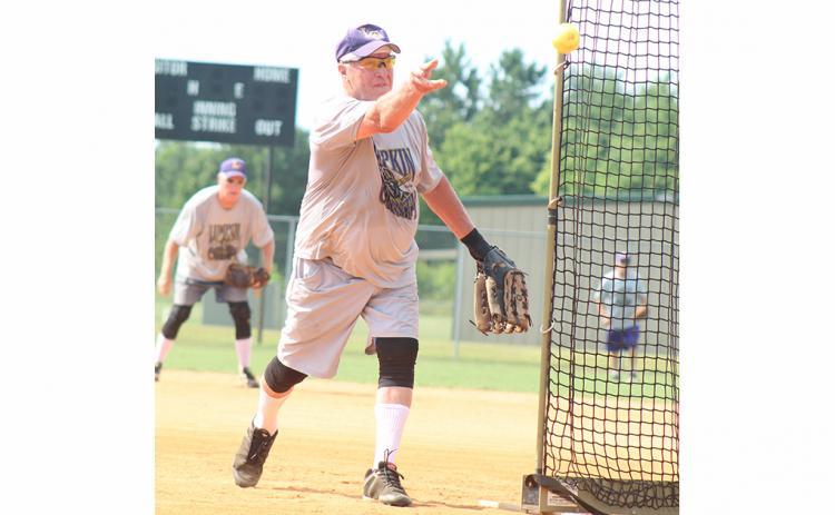 "LC Miner pitcher Larry ""The Rocket"" Rodgers tosses a strike towards home plate during the Miners' league doubleheader against the Rabun County Relics last week."