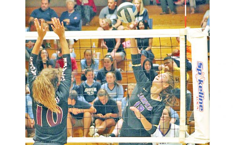 Lady Indians player Victoria Crotzer gets her team a point with a powerful hit at the net.