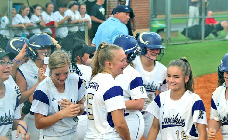 Evee Dornhecker is mobbed by her teammates after belting a game-tying solo shot to left field during the Lady Indians' game versus East Hall.