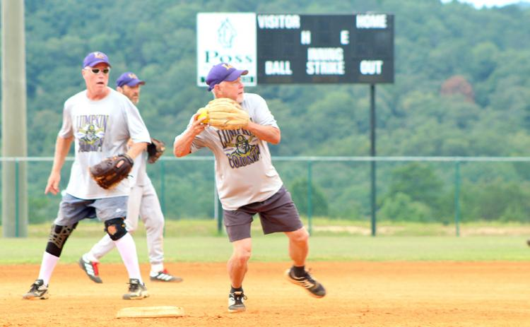 "Lumpkin shortstop Wayne ""Got Em"" Gaddis turns a double play during the Miners' matchup with the Gordy Scargle Division leading Hendersonville Sluggers."