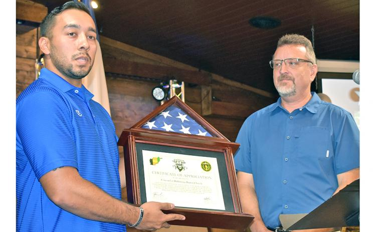 Recently returned Georgia National Guard 2nd Lt. Edgar Rojas (left) presents Pastor Jeff Pullium of Concord at Dahlonega with the flag that flew over the base at Nangarhar Province, Afghanistan where he was stationed. The presentation took place during the church's recent Warrior Welcome Home celebration.