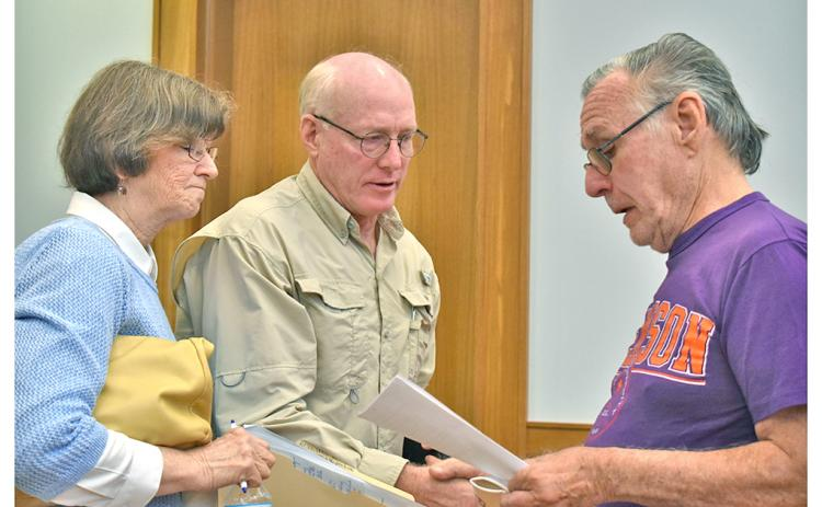 "Dr. Laurel and Kurt Massey share a copy of a proposed resolution to declare Lumpkin County to be a ""Sanctuary for Pre-born Life"" with Byron Jeffries."
