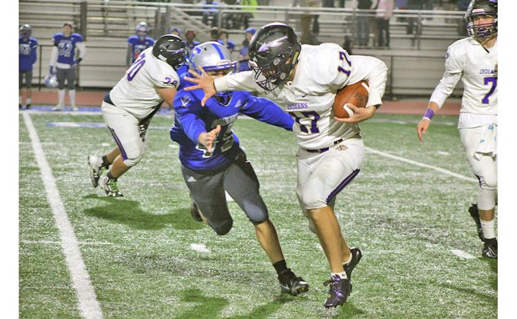 Running back Drew Allison returned from an injury with a vengeance Friday night, stiff arming a Fannin County defender on his way to a first down. (Photo by Jake Cantrell/The Nugget)