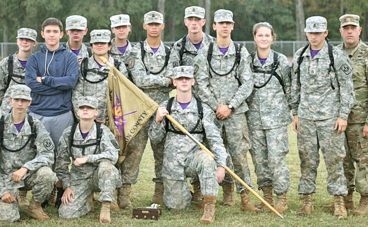 The Lumpkin County JROTC Raider team is pictured after the awards ceremony at the State Competition at Spalding High School. Pictured (from left) standing: Ashlyn Jewell, Mario Mendoza, Chase Cootware, Emily Martinez, Tatianna Lovell, Dane Sexton, Bailey Amey, Cody Gaddis, Madison Rodgers, Reece Butler and coach Jeff Moran. (Kneeling) Brigham Talton, Melia Matkovic and Levi Bennett.