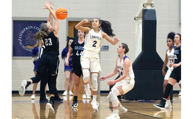 Lumpkin County's Isabel Davenport forces a Lady Leopard turnover with her tenacious defense.