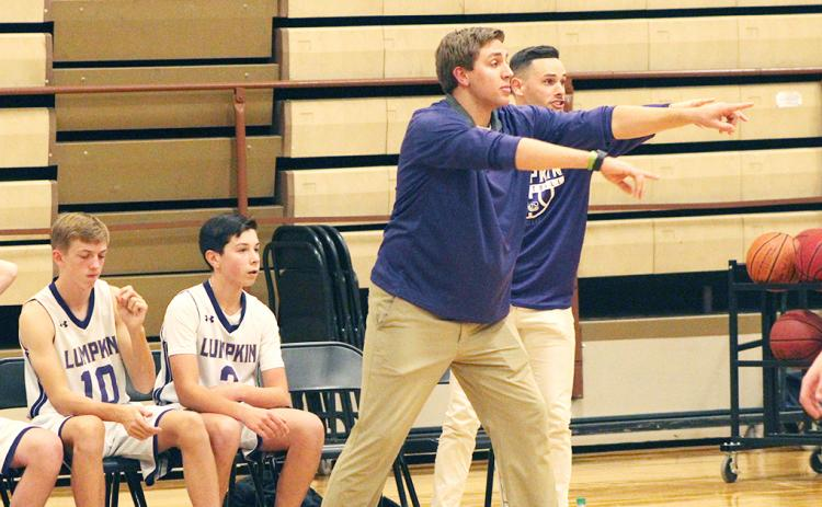First-year middle school head boys basketball coach Daniel McCrary directs his players during their game against the Pickens County Dragons at the LCMS gym last week.