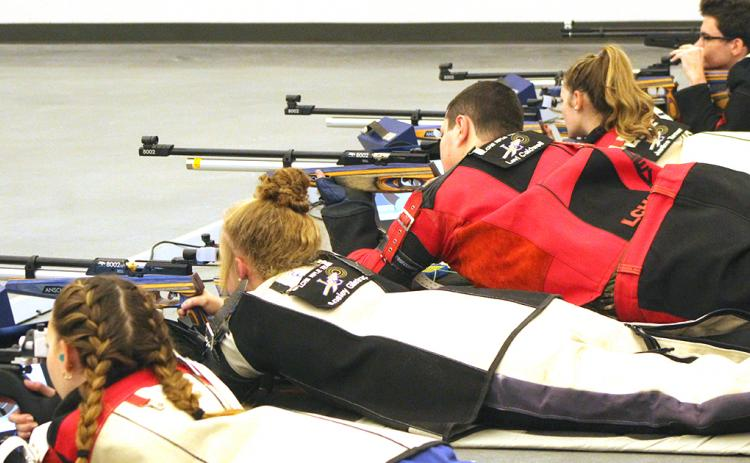The LCHS rifle team takes aim during a match at the Hunting Grounds rifle range. The Indians defeated Roswell High School last week to improve to 2-1 on the season.