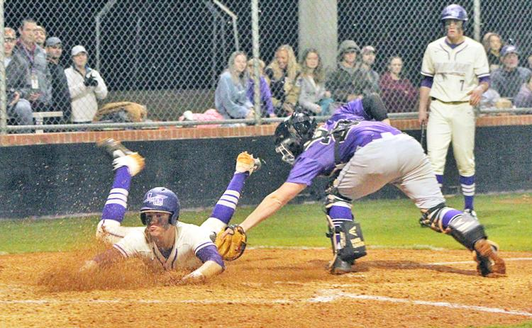 Lumpkin County's Dalton Caldwell slides safely into home plate to score a run in Lumpkin's 3-0 win over the Union County Panthers in their 2020 home opener on Tuesday, Feb. 25.