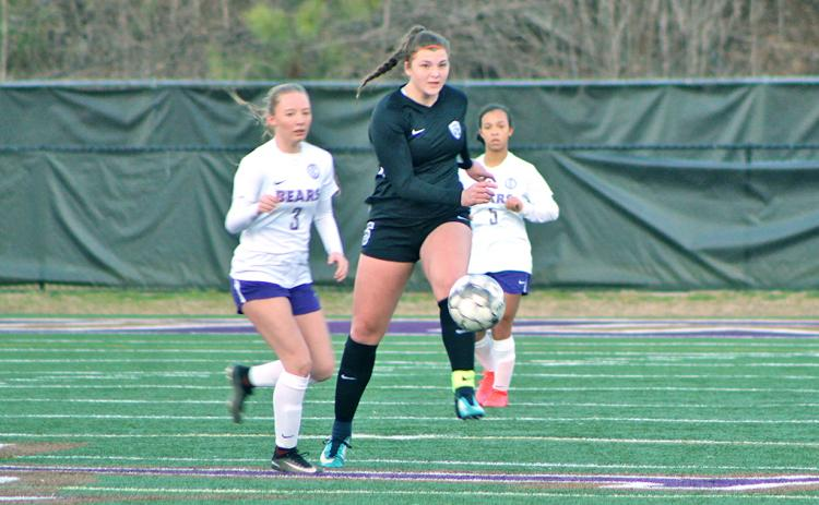 Lumpkin midfielder Reagan Spivey clears a ball during the high school team's win over Cherokee Bluff. Spivey scored one of the six goals for the Lady Indians in the victory.