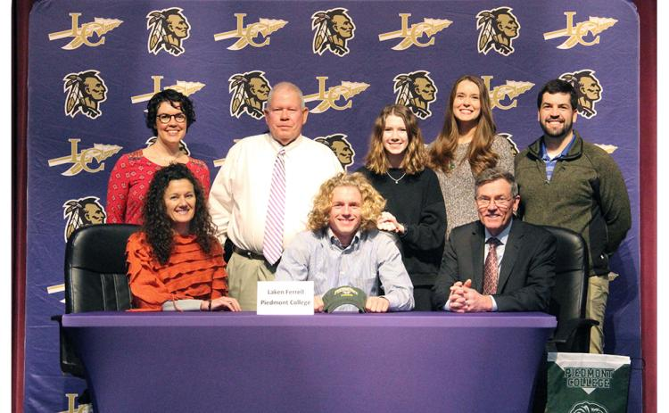 LCHS tennis star Laken Ferrell (center front) celebrates signing with Piedmont College at a recent signing ceremony held at the LHS auditorium. Pictured (back row, left to right): Abbey Ferrell, LCHS head tennis coach Alan Hogan, Claire Stephens, Erin Ferrell and Jay Ferrell. (Front row): Ferrell's mother Paige Ferrell and Ferrell's father Steve Ferrell.