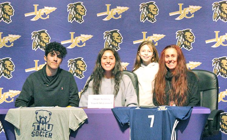 Lady Indians all-time leading goal scorer Hope Kenney (center) celebrates signing with Truett McConnell University at a signing ceremony held at the LCHS auditorium. Pictured (left to right): Kenney's twin brother Jack Kenney, Kenney's sister Raini Chandler and Kenney's mother Rachel Kenney.