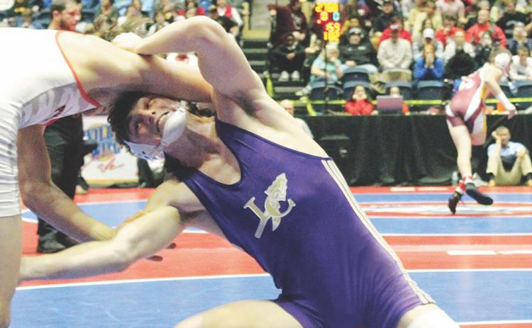 Lumpkin wrestler Sam Irwin takes a shot on his opponent's leg in the finals match of the GHSA State Wrestling Championship this past season.