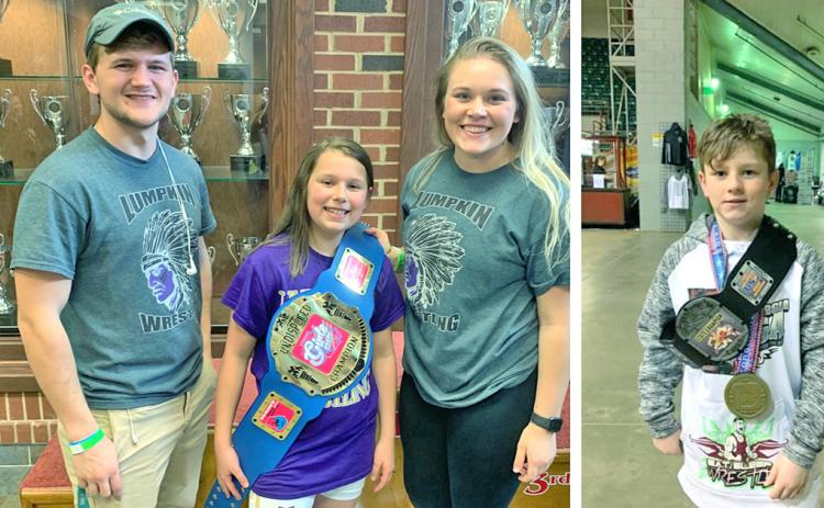 LEFT: Caroline Cunningham celebrates her State Championship title with Lumpkin County Youth Wrestling Club coach Tristin Duckworth and her wrestling idol Kaylee Seabolt.  RIGHT: Caleb Yorkey shows off his State Champion belt and medal after an overtime win in the finals. Yorkey became the first USA wrestling champion for Lumpkin County in years.