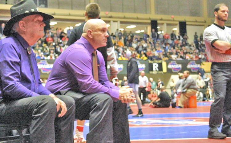 LCHS head wrestling coach Sean Hage (pictured here with LCHS assistant coach Ed Wright on the left) believes that the rules changes the NFHS made recently were a step in the right direction.