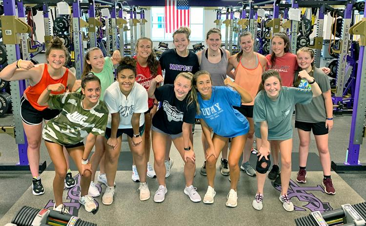 Members of the LCHS girls basketball and LCHS volleyball team take time out of their group conditioning workout to pose for a photo. Due to the many players that are on both the basketball and volleyball team, the two teams have joined together during the first two weeks of resumption of sports activities under the GHSA's COVID-19 guidelines.