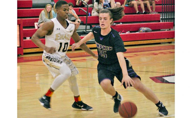 Former LCHS basketball standout Jack Howard dribbles past a defender for two points, displaying the skills that helped him become a UNG Nighthawk. Howard, who stepped away from the sport he loved for a short time, will be back on the court for his last year of college eligibility after transferring to Reinhardt University and joining the Eagles' basketball program.