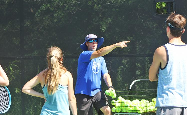 UNG head tennis coach gives instructions for a drill to campers of the UNG tennis camp last week.