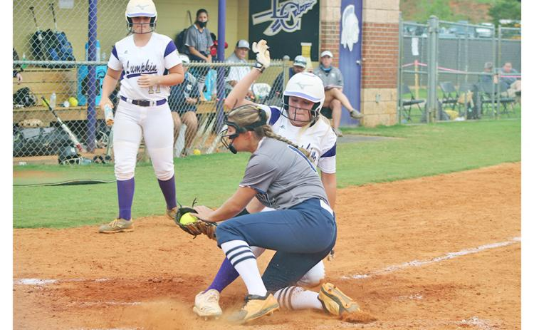 Lady Indians right fielder Haley Voyles slides in safely at home after a wild pitch by White County's pitcher. Voyles had a solid performance against the Lady Warriors in the Lumpkin win.
